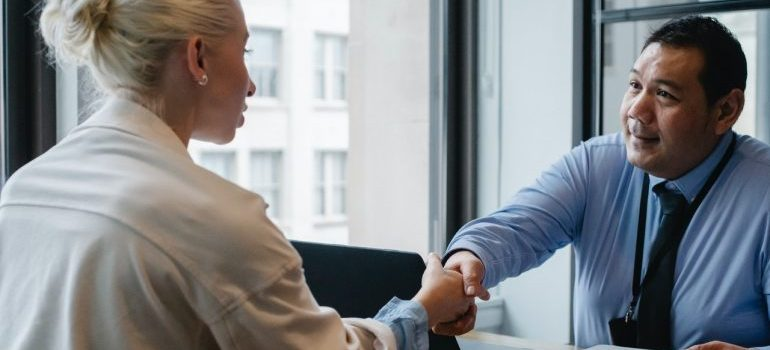 Woman meeting with mover to check moving company credibility
