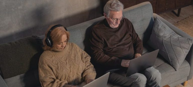 An elderly couple researching for a move.