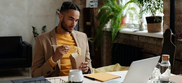 A man readin up on all the benefits of decluttering your office space.
