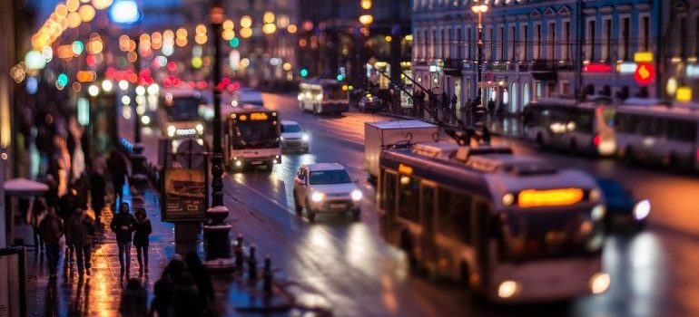 A view of a street at night that is filled with vehicles.