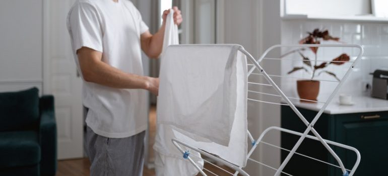 A man spreading laundry to dry