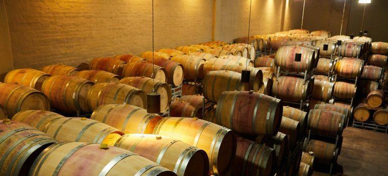 A basement filled with barrels.