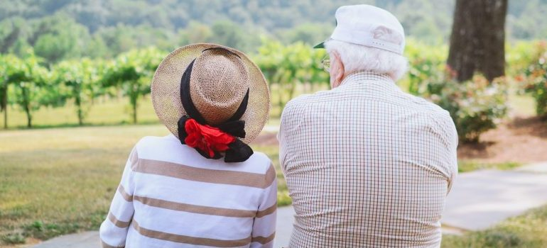 two seniors strolling through the countryside
