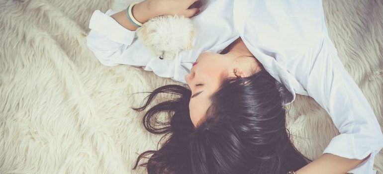 A girl sleeping on a bed.