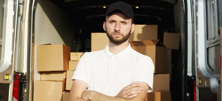 Man standing in front of a moving van.