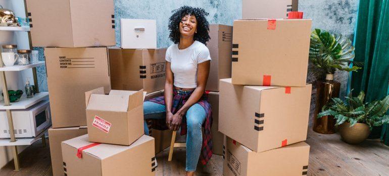 a girl sitting among boxes