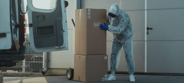 person moving from Boise to Phoenix in a sanitary suit
