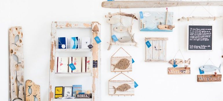 Items on the wall to get rid of in order to simplify your home after moving.