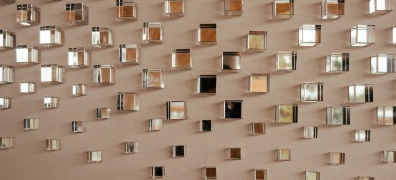 a lot of small mirrors on a wall